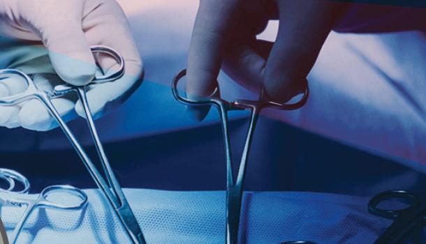Surgeons handling scissors