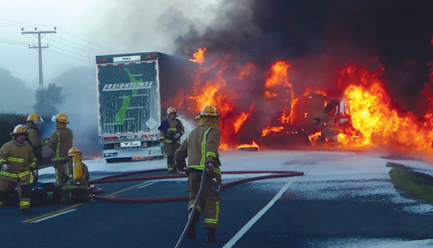 Crash scene with firefighters on New Zealand road